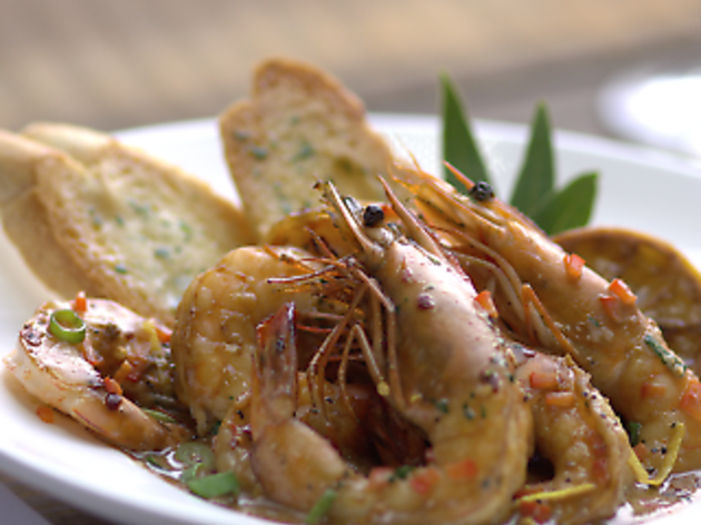 Barbecued shrimp in a bowl with bread