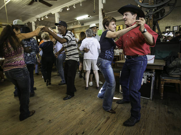Couples on the dance floor as Corey Ledet and his Zydeco band perform Saturday morning during the cafe's weekly zydeco breakfast in Breaux Bridge, Louisiana.