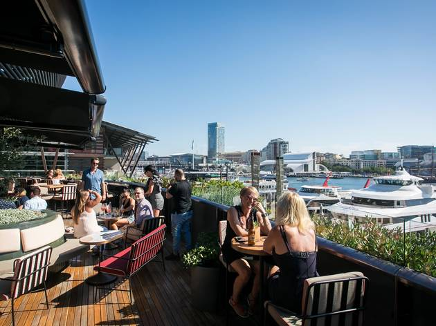 People sitting outside drinking at Smoke Bar Barangaroo