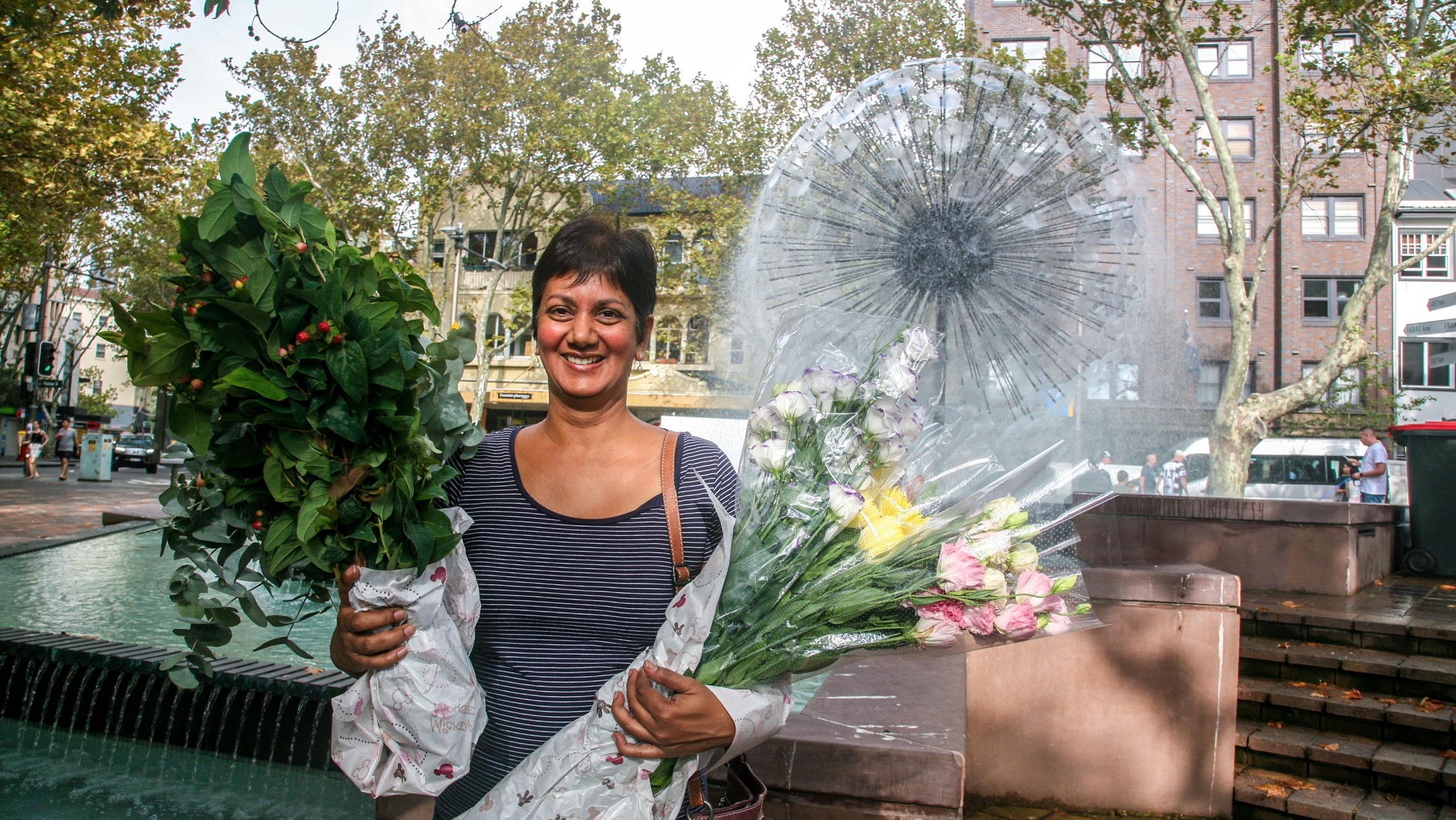 Person with flowers at Kings Cross Market