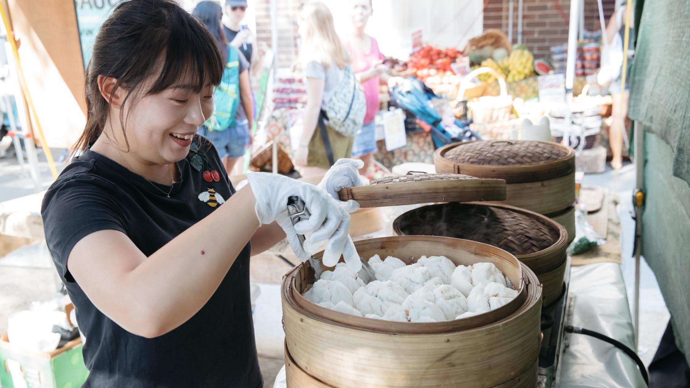 Person making food at Bondi Farmers Markets