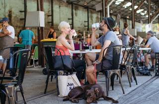 People drinking coffee at Carriageworks Farmers Markets