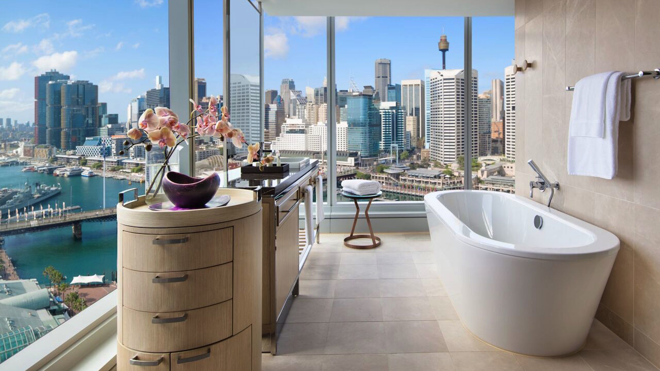 A bathroom of Sofitel Sydney Darling Harbour with a view out over the water