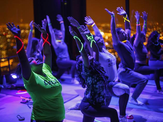 Watch 170 yogis Flow in the Dark at 360 CHICAGO