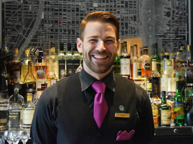 Bartender Jesse smiles at the Library Bar in the Rittenhouse Hotel