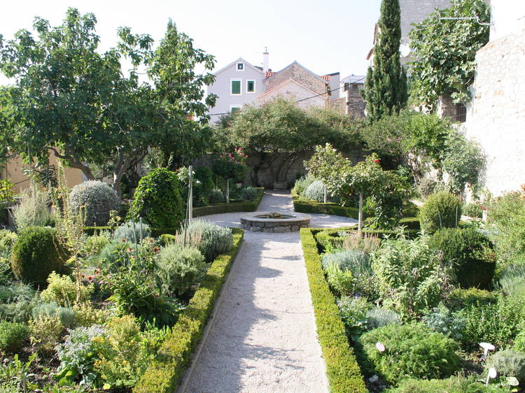 Visit the gardens around St Lawrence Monastery