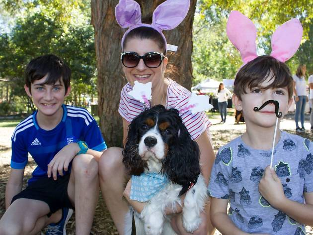 Family enjoy's the Mad Paws Easter Fair with their dog.