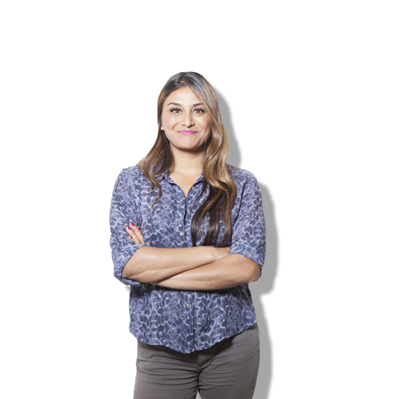 Trishna stands against a white backdrop