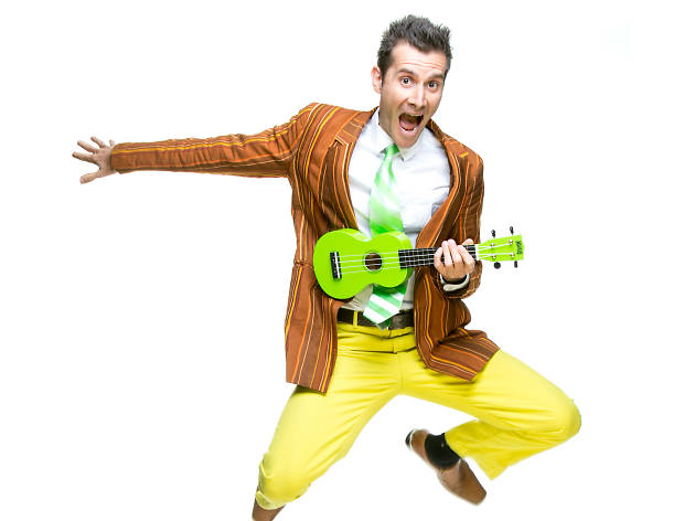 Mr Snot Bottom plays a green ukulele and dances