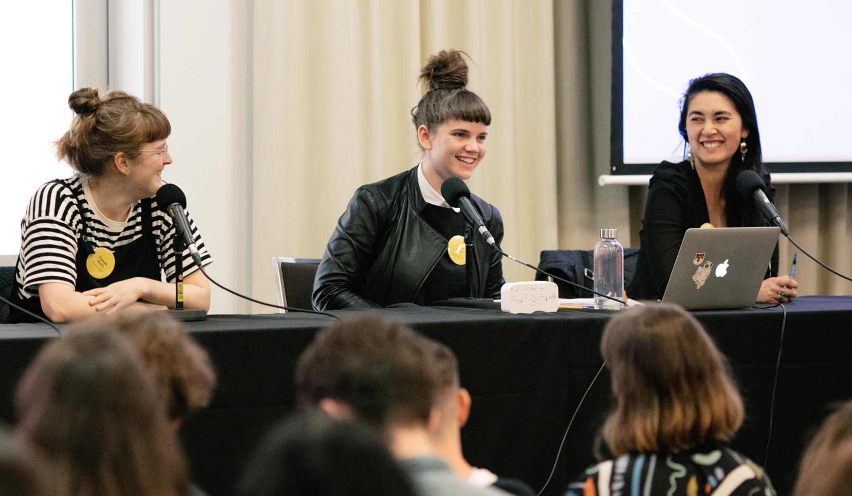 Three women on a panel about podcasts