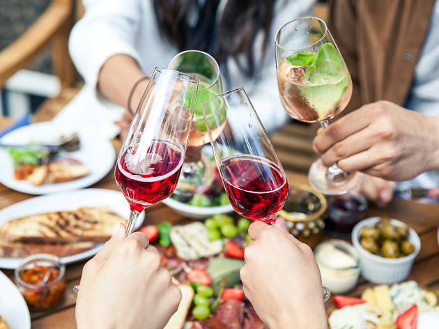 People drink wine and eat at the Spanish Fesitval