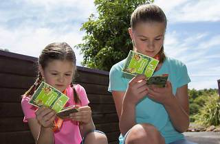 Two kids check out their rangers booklets