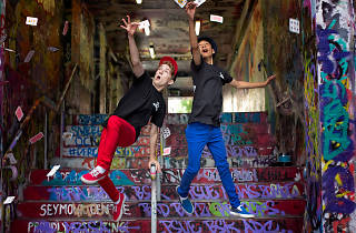 Young magicians the Cardistry Boys throw cards in the air