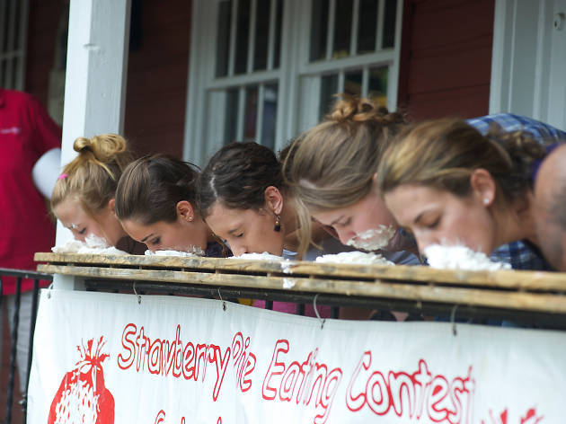 A pie-eating contest is an annual tradition at the Strawberry Festival at Peddler's Village