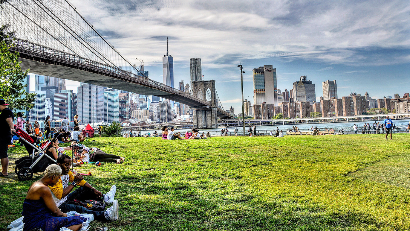 People relaxing in Brooklyn Bridge Park