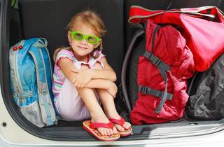 a little girl sitting in the car with backpacks; Shutterstock ID 109891235; Purchase Order: Kids Digital; Job: ; Client/Licensee: Time Out; Other: