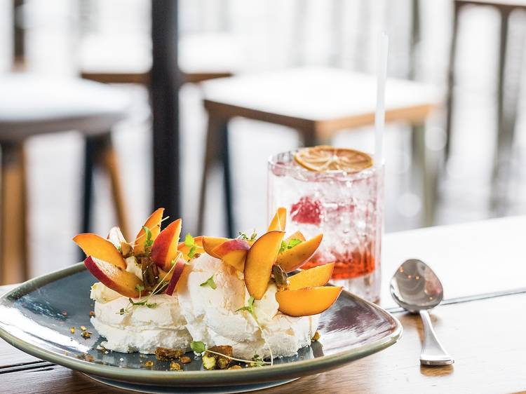 Peach pavlova, mascarpone and pistachio at Riverbar and Kitchen, $14