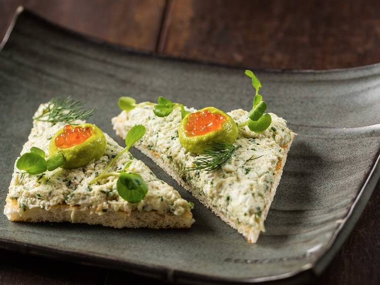 Sand crab on toast, trout roe, avocado at Stokehouse Q, $18