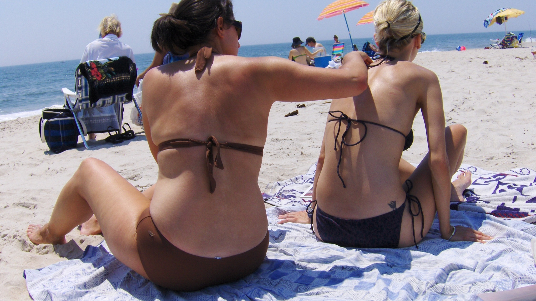 Putting on sunscreen at beach