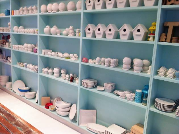 A range of ceramics on a blue shelf ready to be painted.