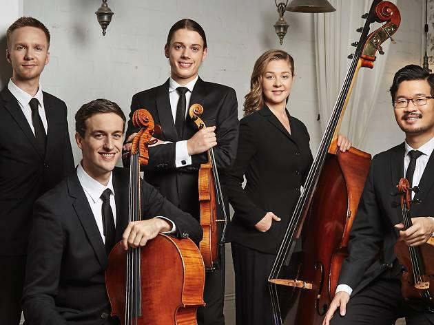 Sydney Symphony Orchestra fellows sit with instruments.