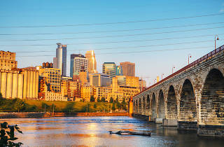 Downtown Minneapolis, Minnesota in the morning with famous Stone Arch bridge