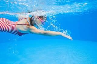 little girl swimming in pool; Shutterstock ID 657728425