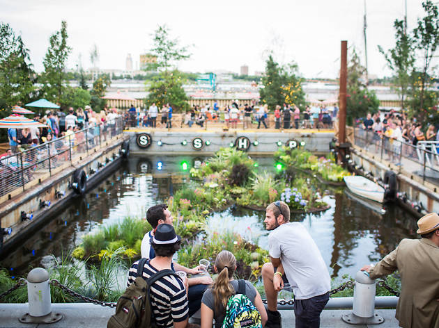 Check out the floating barges at Spruce Street Harbor Park for unique alfresco drinking and dining.