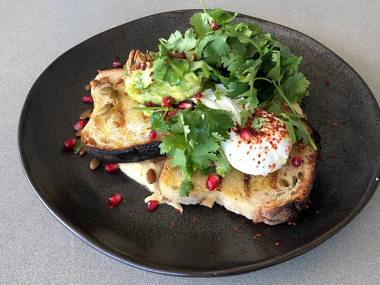 Avocado, sourdough, poached egg and hummus at Odyssea, $19