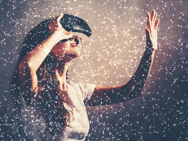 Young woman using a virtual reality headset with conceptual network lines; Shutterstock ID 552221818