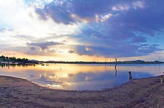 The tranquil Kanchikudichchiaru reservoir against the backdrop of serene nature