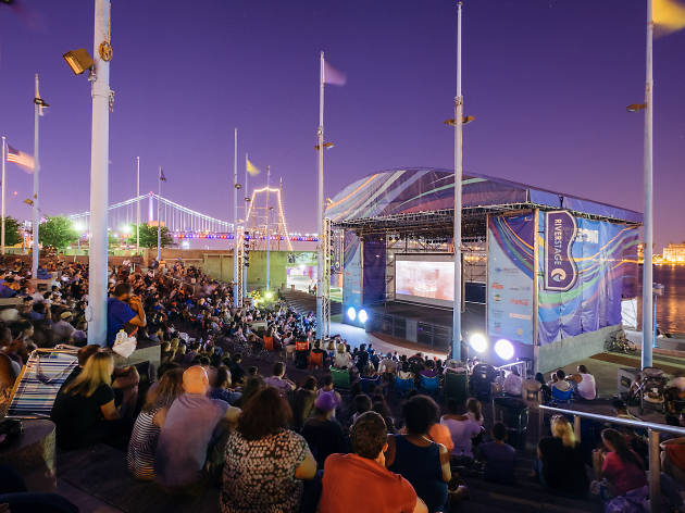 Families gather around the big screen each summer at Penn's Landing's Screenings Under the Stars.