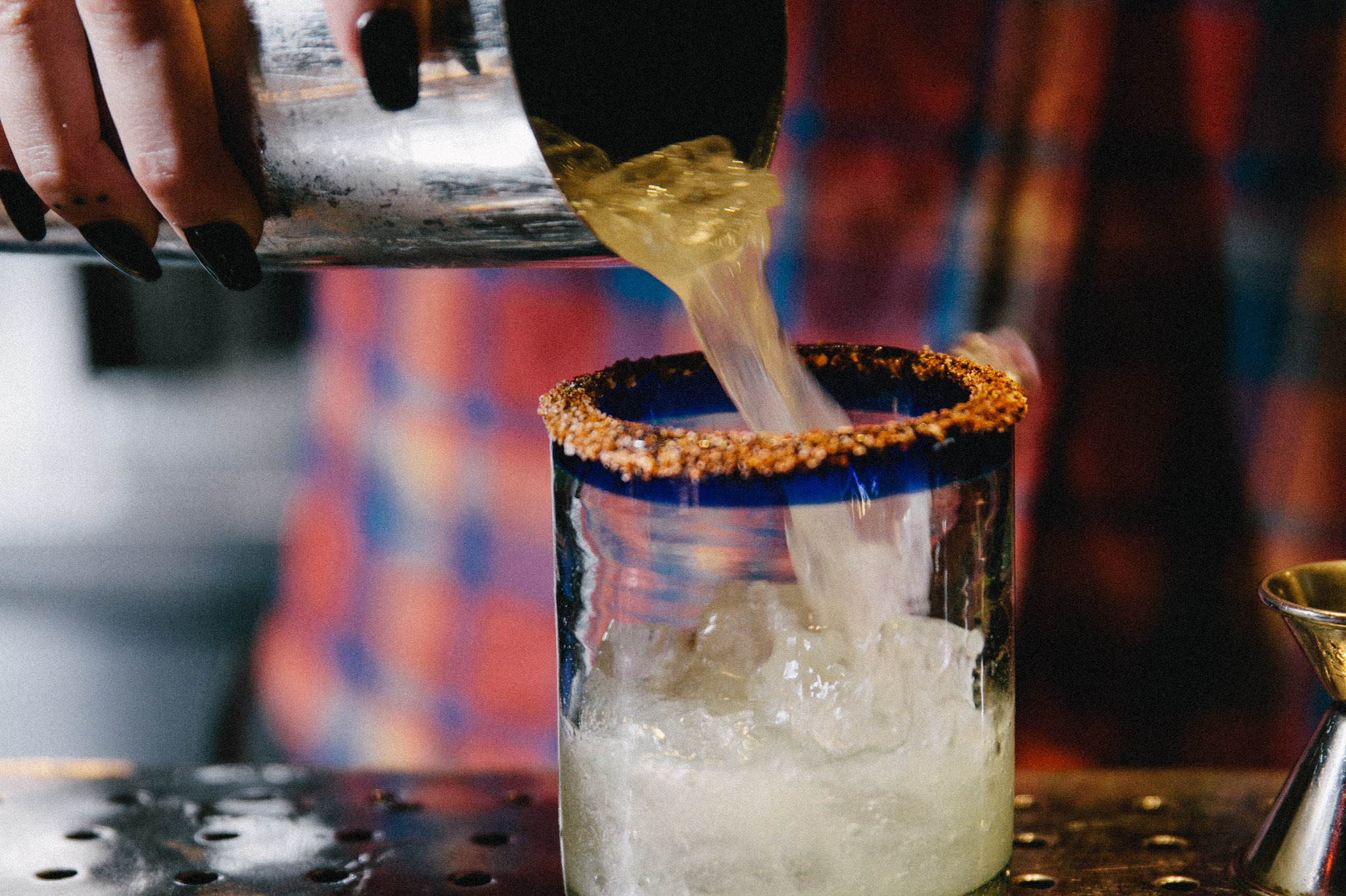 A bartender pours a margarita at El Rey, a Stephen Starr joint near Rittenhouse Square.