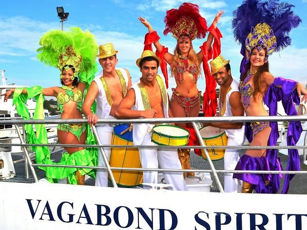 Brazilian dancers pose of the Vagabond Spirit vessel.
