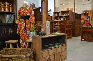 A collection of Japanese and Chinese fabrics and furniture on display in at Tombo