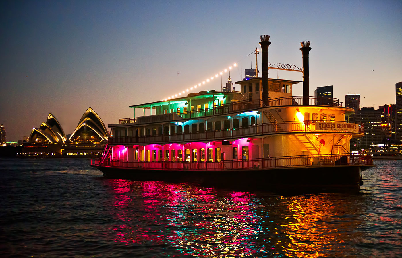 Cruise ship on Sydney Harbour in front of the Opera House.