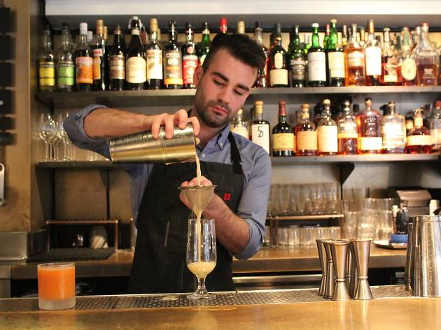 A bartender whips up a cocktail at a.bar, which has a very creative drinks list.