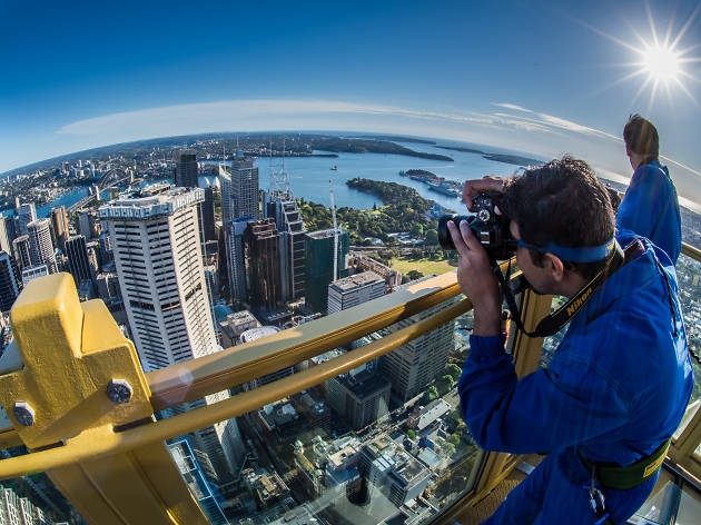 People take photos of the city from the Tower Eye.