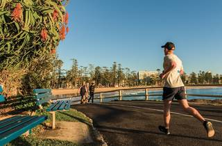 Man running at Manly Beach walk