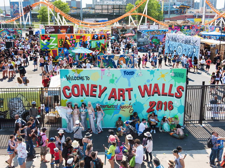 Pose for photos in front of the Coney Art Walls