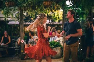 People dancing in the garden.