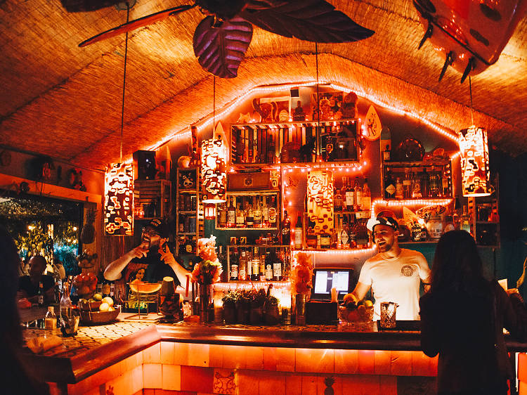 Check out the best tiki bars in Miami for tasty umbrella drinks