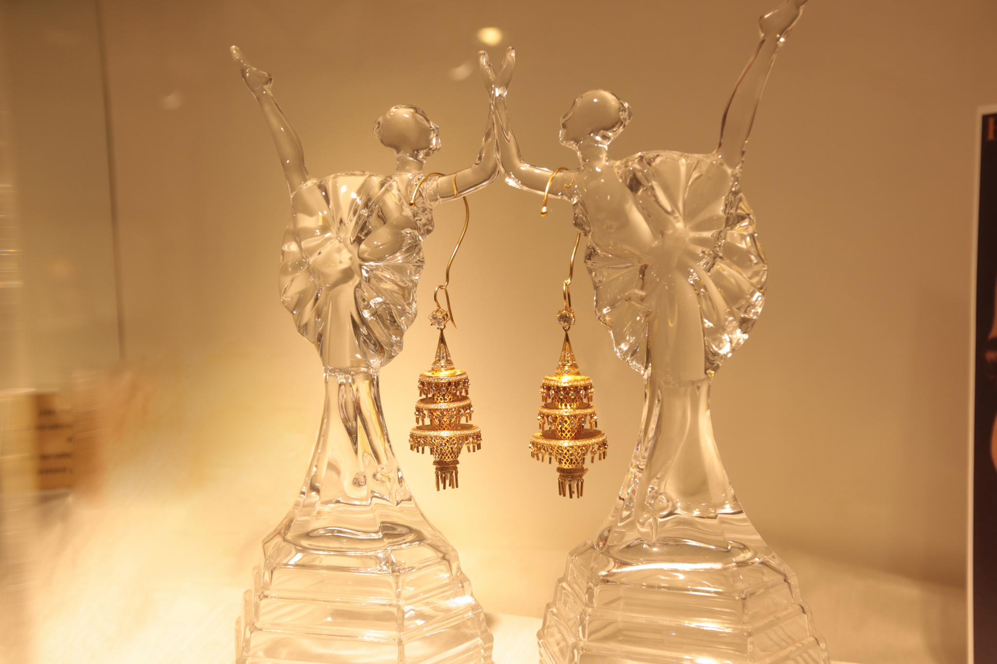 A dazzling pair of dangling gold earrings at Vogue Jewellers