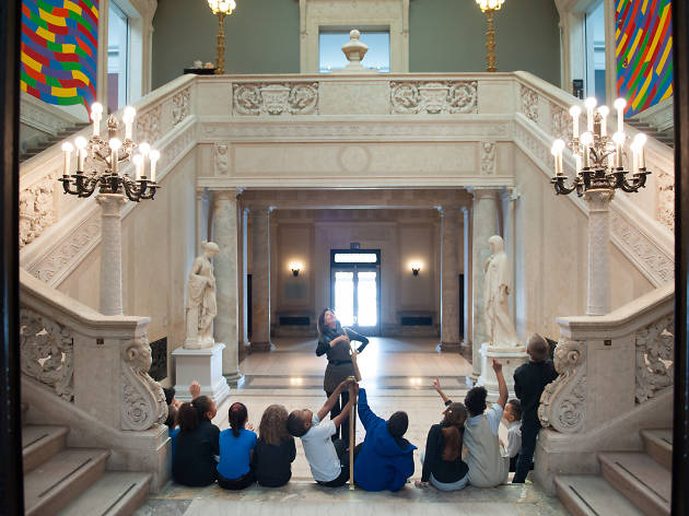 Children sit in the lobby of the Wadsworth Atheneum Museum of Art