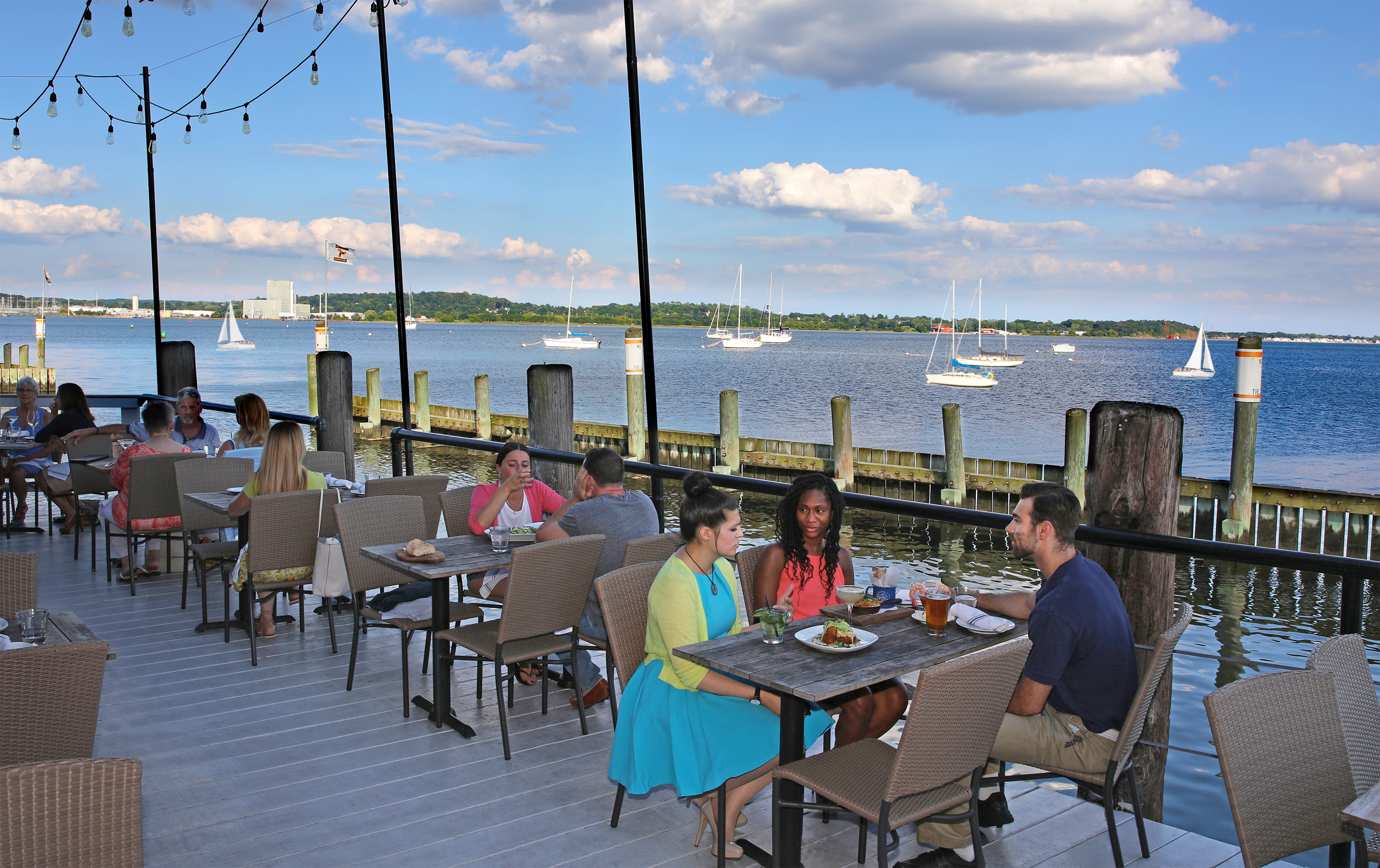 Diners eat by the water at Shell and Bones Connecticut
