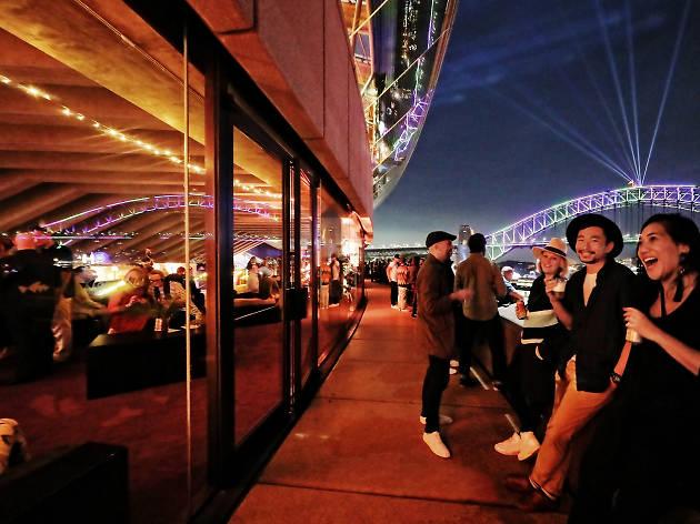 People enjoy a bar during Vivid.