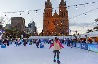 People on the ice rink outside Cathedral Square.
