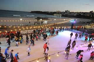 People ice skating by Bondi beach.