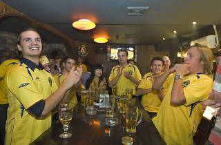 Soccer fans cheer in sports bar