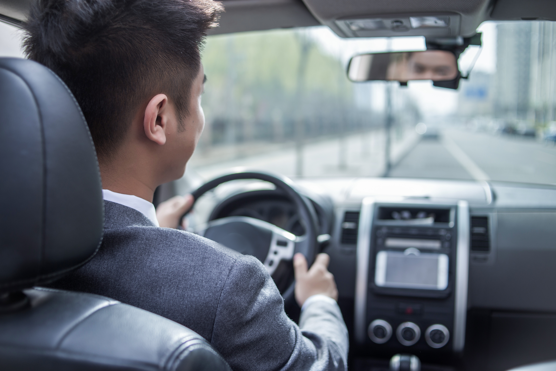 Asian man driving